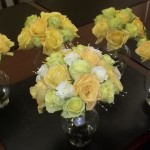 "Spring bouquets featuring  white ""Escimo"", green ""Jade"", and yellow ""Skyline"" roses."