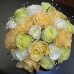 Bridal bouquet of roses with a touch of pearls mixed in.