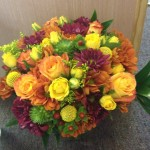 Bright mix of summer yellows and greens with fall oranges and plums.
