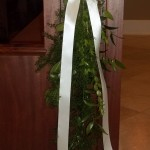 A gathering of greenery is an elegant choice for pew markers.
