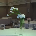 Simple and elegant, hydrangea support draping calla lilies.