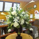 Green and white flowers are a popular elegant choice.