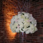 This mix of hydrangea and roses stands floor to ceiling at the Cannery Ballroom with the vase and curling willow.