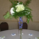 Submerged delphinium adds a pop of color to white and green flowers.