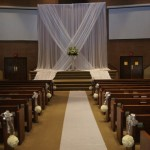 Contemporary altar setup with pomander aisel markers.