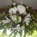Archway/Gazebo arrangements are a great alternative to traditional fan shaped altar arrangements.