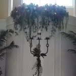Floral accents can be customized to your event venue like the baptisimal draping seen here.
