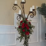 candelabra adornment of red roses and gerbers