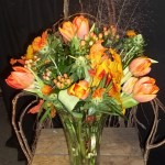 Mixed orange blooms. We can design with a favorite color in mind.