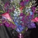 Airy handtied bouquet of jewel tone flowers