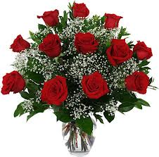 Dozen red roses with greenery and babies breath.