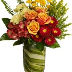 Contempary grouped style with roses, matsumoto aster, alstromeria, carnations, solidego and button mums.