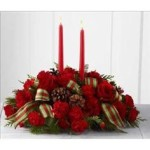 Nothing sheds a Christmas glow to your holiday table better than flowers.